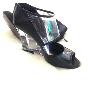 Glass heel to toe, black designer shoes from Aldo
